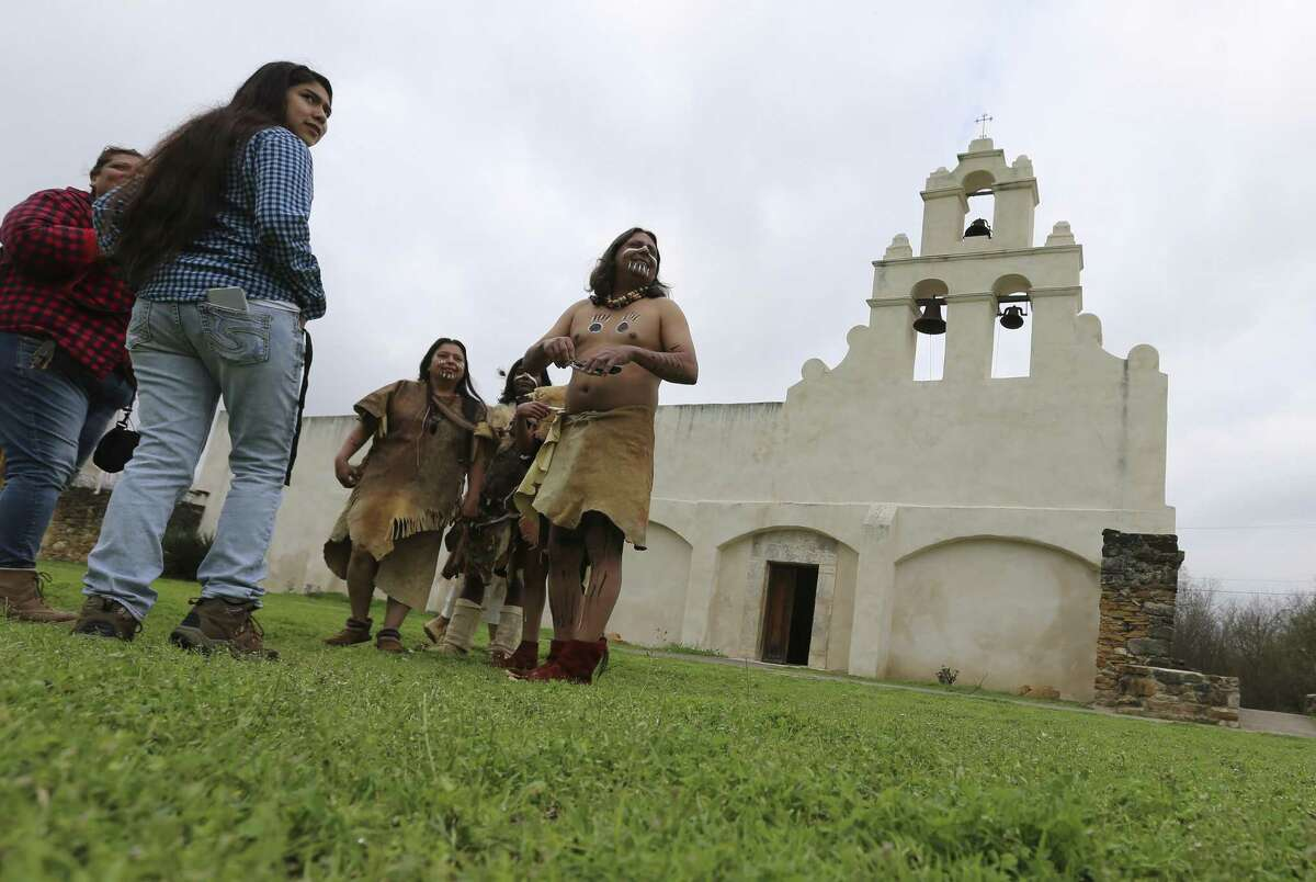 Jose Lopez (center) with his, Arlene, and his sons wear period clothing for a play at the Tricentennial Founders' Feast Day, which commemorates the March 5, 1731, Acto de Posesión, when the Franciscan priests handed over ownership of Missions Concepción, San Juan Capistrano and Espada to the Native American families residing there.