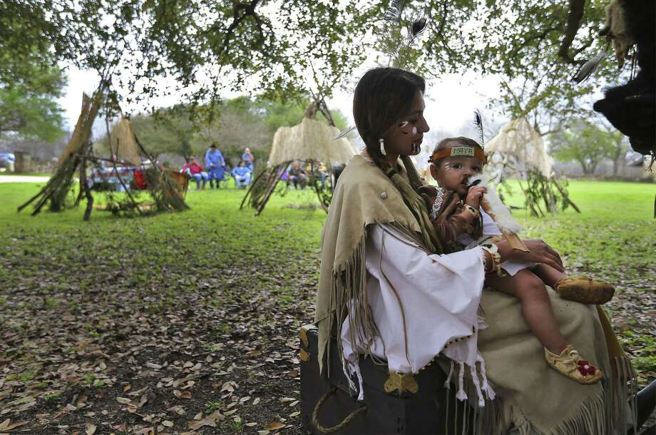 Mariana Avila cares for her infant daughter, Maya, as they wait to participate in a play at the Tricentennial Founders' Feast Day. Photo: Kin Man Hui /San Antonio Express-News / ©2018 San Antonio Express-News