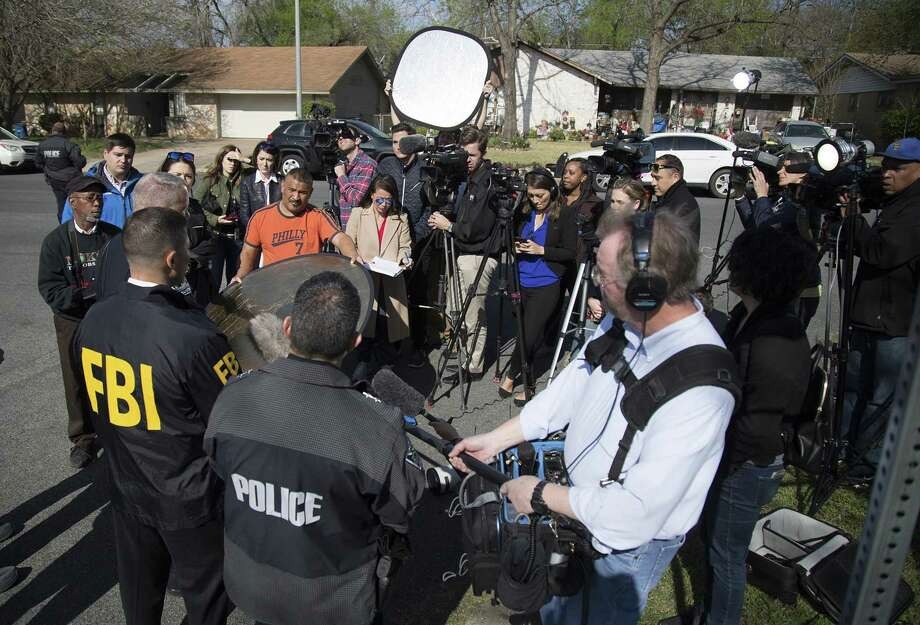Authorities and media at the scene in East Austin after a teenager was killed and a woman was injured in the second Austin package explosion in the past two weeks on March 12. Photo: Ricardo B. Brazziell /Austin American-Statesman / Austin American-Statesman