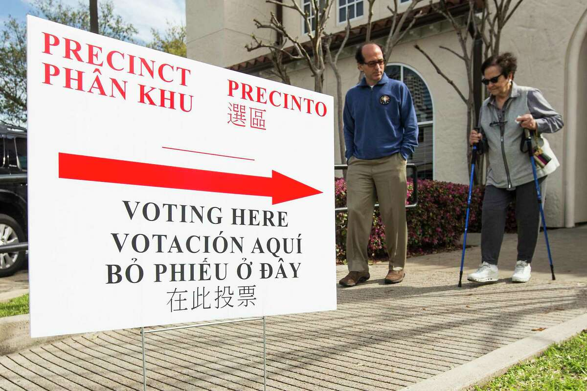 Voters walk out of the primary election polling place at St. Anne's Catholic Church on Tuesday, March 6, 2018, in Houston. ( Brett Coomer / Houston Chronicle )