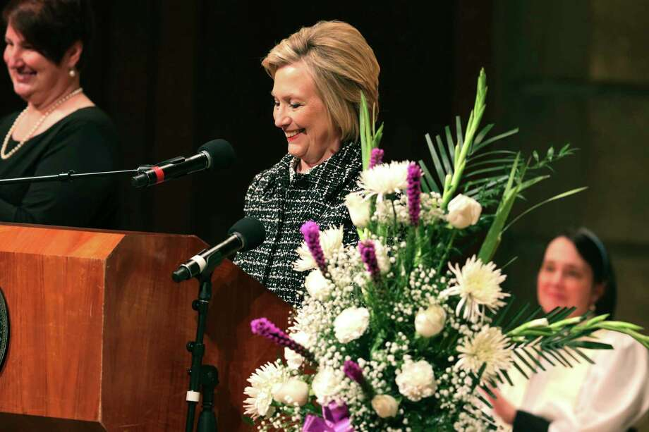 "Former Secretary of State Hillary Rodham Clinton tells a funny memory of how after New York Congresswoman Louise Slaughter broke her leg, she told Clinton she had a new slogan, ""vote for Louise, she has a leg up,"" during the funeral service for Slaughter at Kodak Hall at Eastman Theatre in Rochester, N.Y., Friday, March 23, 2018. (Tina MacIntyre-Yee /Democrat & Chronicle via AP) Photo: Tina MacIntyre-Yee / Democrat and Chronicle"