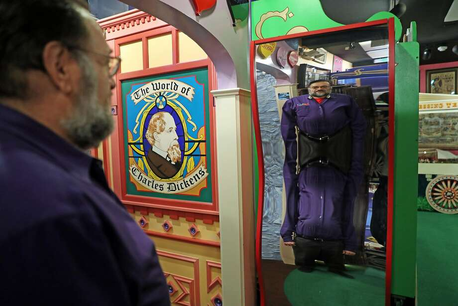 Proprietor Frank Biafore looks into a fun house mirror at Playland-Not-at-the-Beach in El Cerrito. Photo: Scott Strazzante, The Chronicle