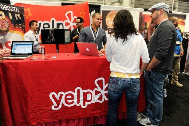 LAS VEGAS, NV - MARCH 20:  A general view of the Yelp booth the 28th annual Nightclub & Bar Convention and Trade Show at the Las Vegas Convention Center on March 20, 2013 in Las Vegas, Nevada.  (Photo by David Becker/Getty Images for Nightclub & Bar Media Group)