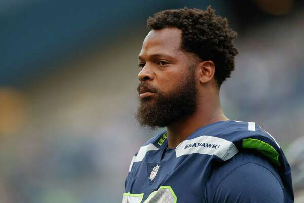 SEATTLE, WA - AUGUST 18: Defensive end Michael Bennett #72 of the Seattle Seahawks looks on prior to the game against the Minnesota Vikings at CenturyLink Field on August 18, 2017 in Seattle, Washington. (Photo by Otto Greule Jr/Getty Images)