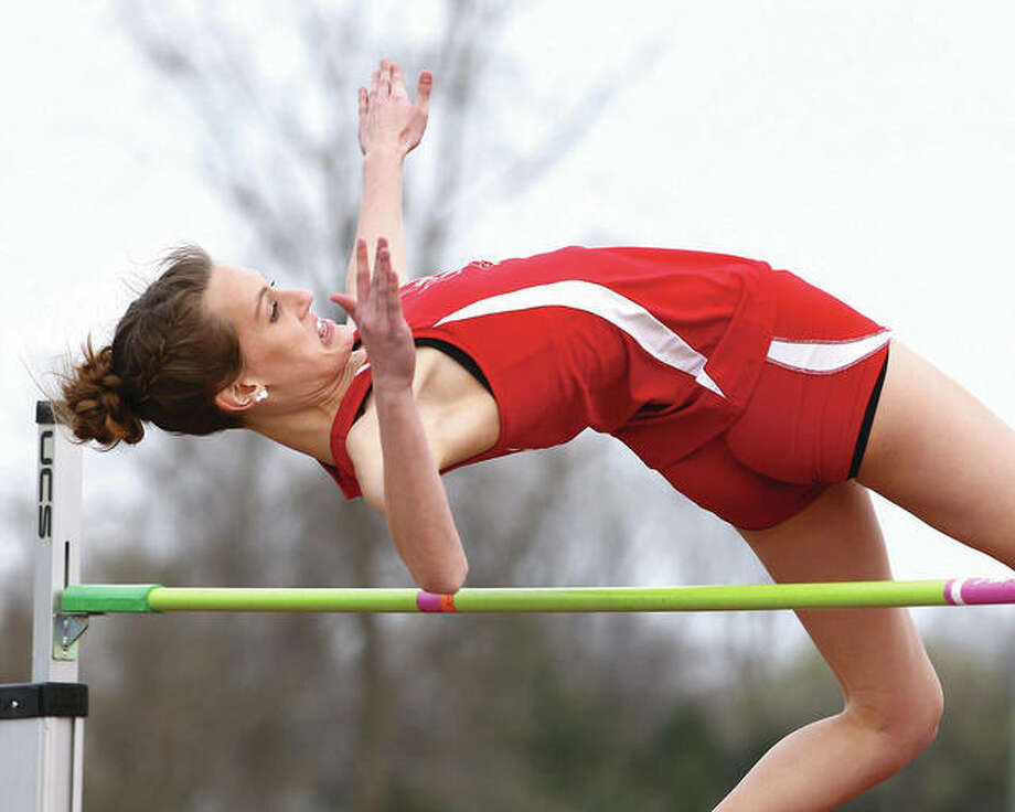 Alton's Katie Mans, shown clearing 5 feet, 4 inches to win the Southwestern Illinois Relays last season, was unable to defend her meet title Friday because of illness. But the Redbirds still put up a big day to finish third in the event's girls division at the Winston Brown Track and Field Complex in Edwardsville. Photo: Billy Hurst / Telegraph File Photo