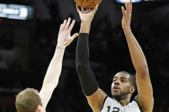 San Antonio Spurs' LaMarcus Aldridge shoots a 3-pointer over Utah Jazz's Joe Ingles  during first half action Friday March 23, 2018 at the AT&T Center.