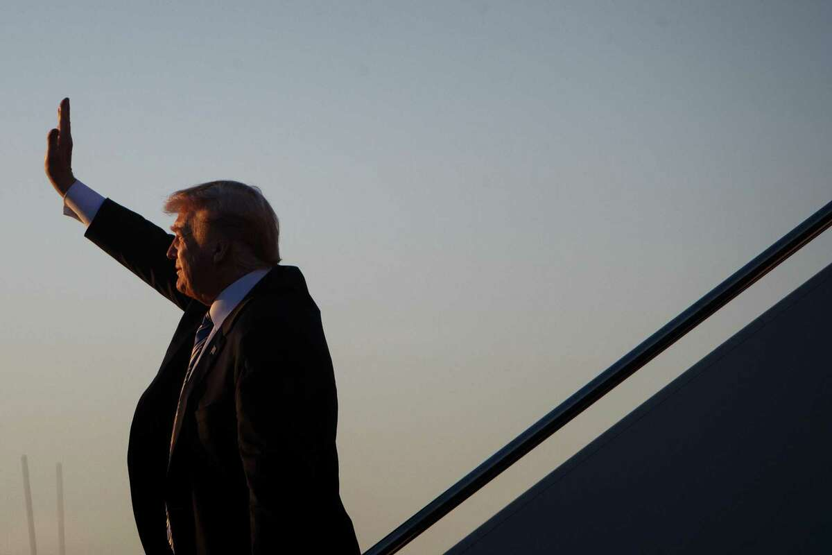 President Donald Trump arrives aboard Air Force One, at Palm Beach International Airport in West Palm Beach, Fla., March 23, 2018. As Trump headed to his Mar-a-Lago resort after a particularly tumultuous week, officials at the White House and in Congress were equally mystified about what might come next. (Tom Brenner/The New York Times)