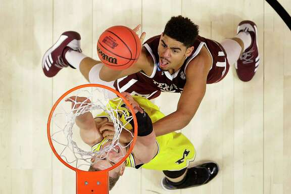 Texas A&M center Tyler Davis, top, a first-team All-SEC selection, hasn't decided if he will return next season.