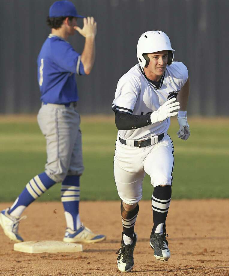 Jordan Thompson sprints out of his double on a pass ball to claim third base also as Champion hosts Tivy in boys baseball at Champion HIgh School on March 23, 2018. Photo: Tom Reel, Staff / San Antonio Express-News / 2017 SAN ANTONIO EXPRESS-NEWS