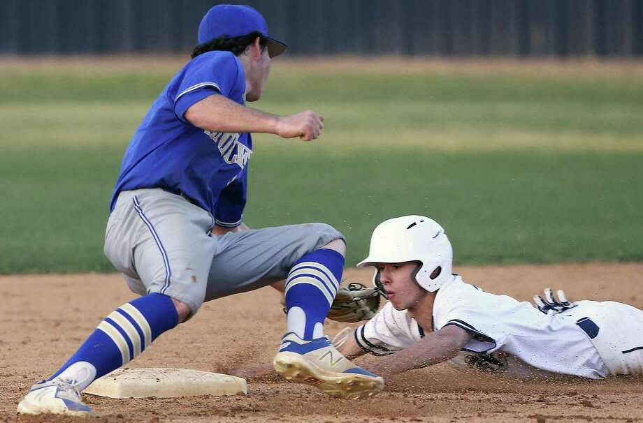 Chargers' base runner Josh Bentzinger is tagged before he can steal second by Cole Miears as Champion hosts Tivy in boys baseball at Champion HIgh School on March 23, 2018. Photo: Tom Reel, Staff / San Antonio Express-News / 2017 SAN ANTONIO EXPRESS-NEWS