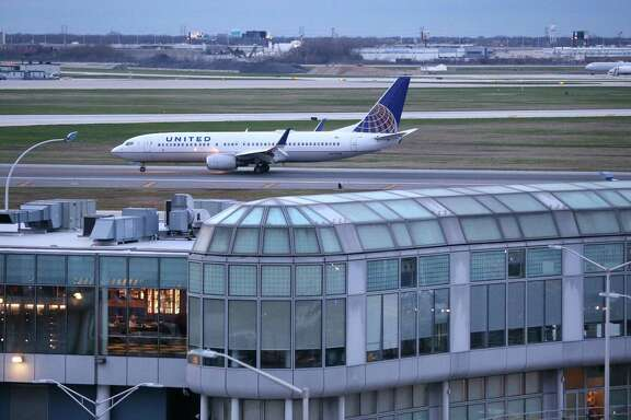 A United Airlines airplane rolls down the runway after landing at O'Hare Airport in Chicago.