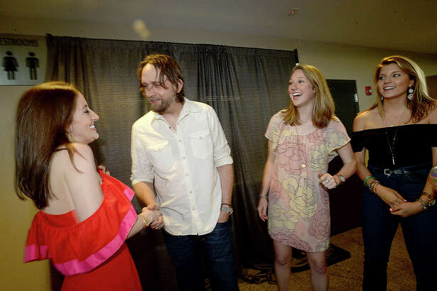 Morgan Rippy greets Hayes Carll as Monica Lee and Kirby Stevens look on during a meet and greet for VIP's at Ale Waggin Good Time, which featured a performance by Carll at the Event Centre Friday. The dinner and show benefits the Humane Society of Southeast Texas. Photo taken Friday, March 23, 2018 Kim Brent/The Enterprise
