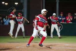 Dawson's J.P. Marrero (21) celebrates after scoring run against Pearland Friday, Mar. 23 at Pearland High School.