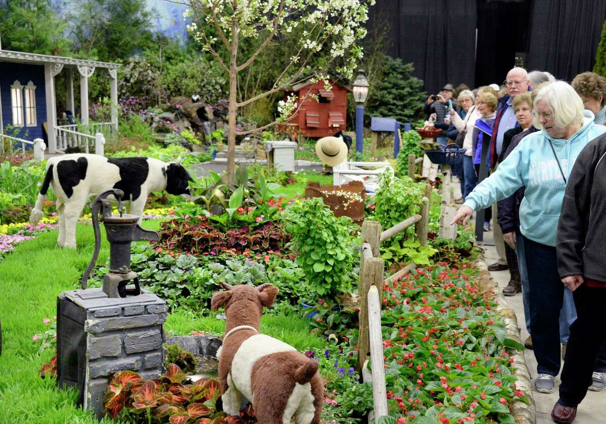 """Crowds marvel at William Mitchell's Design Scapes' """" A Wonderful Country Farm"""" exhibit at the Capital District Garden & Flower Show at HVCC Friday March 23, 2018 in Troy, NY. (John Carl D'Annibale/Times Union)"""