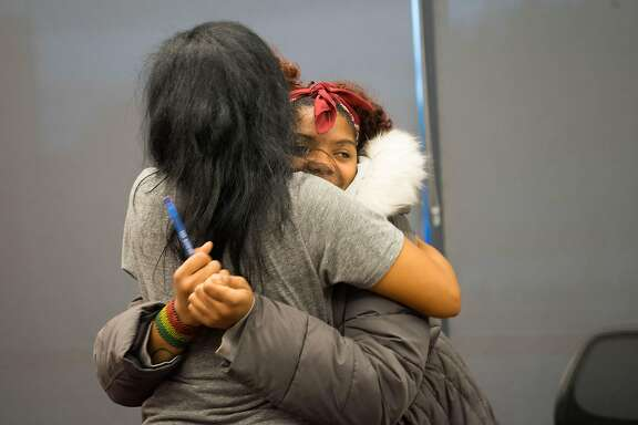Regina Jackson, left, hugs Destiny Shabazz at the East Oakland Youth Development Center in Oakland, Calif. on Wednesday, March 21, 2018. Nine students from Oakland will be attending the March for our Lives event in Washington D.C. where they will be protesting gun violence.