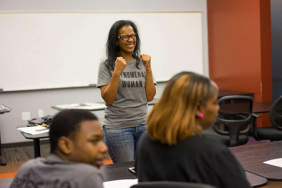 Regina Jackson speaks to students about their upcoming trip to Washington D.C. at the East Oakland Youth Development Center in Oakland, Calif. on Wednesday, March 21, 2018. Nine students from Oakland will be attending the March for our Lives event in Washington D.C. where they will be protesting gun violence.