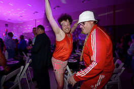 Colin Moore and Patrick Maloney get into character as they joke with one another at St. Anne's 80's-themed dinner, dance and auction held at the school Friday. The event celebrated 80 years of education. Photo taken Friday, March 23, 2018 Kim Brent/The Enterprise