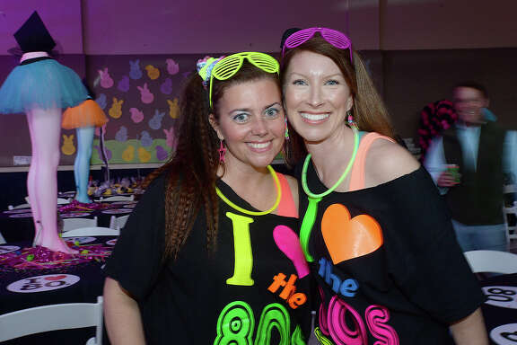 Annie Tyner and Heather Shoemaker were at St. Anne's 80's-themed dinner, dance and auction held at the school Friday. The event celebrated 80 years of education. Photo taken Friday, March 23, 2018 Kim Brent/The Enterprise