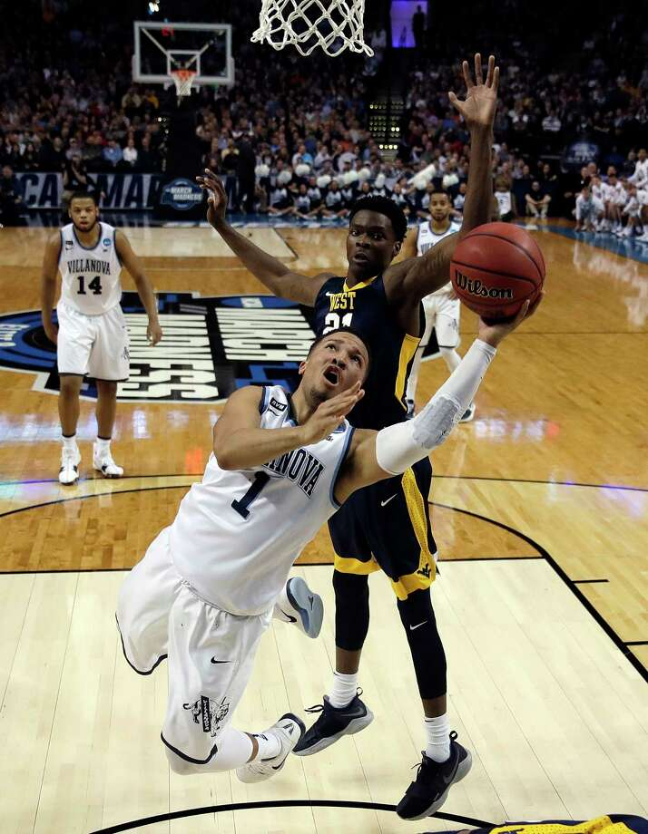 Villanova's Jalen Brunson, front, drives past West Virginia's Wesley Harris during the first half of an NCAA men's college basketball tournament regional semifinal Friday, March 23, 2018, in Boston. (AP Photo/Charles Krupa) Photo: Charles Krupa / Copyright 2018 The Associated Press. All rights reserved.