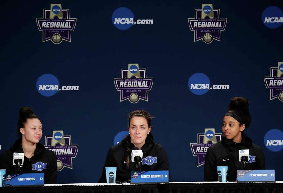 Duke's Faith Suggs, left, and teammate Lexie Brown, watch as Rebecca Greenwell, center, responds to a question during a news conference at the NCAA women's college basketball tournament, Friday, March 23, 2018, in Albany, N.Y. Duke face Connecticut in a regional semifinal on Saturday. (AP Photo/Frank Franklin II) Photo: Frank Franklin II / Copyright 2018 The Associated Press. All rights reserved.