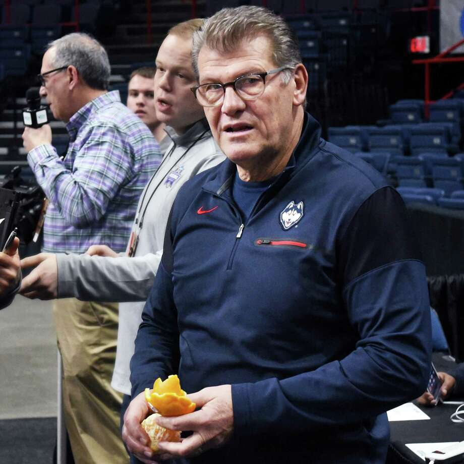 UConn head coach Geno Auriemma peels an orange as he speaks with reporters during their NCAA Women's Basketball regional practice at the Times Union Center Friday March 23, 2018 in Albany, NY.  (John Carl D'Annibale/Times Union) Photo: John Carl D'Annibale / 20043279A