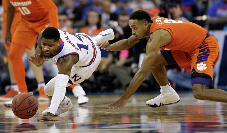 Kansas' Malik Newman, left, and Clemson's Marcquise Reed dive after a loose ball during the second half of a regional semifinal game in the NCAA men's college basketball tournament Friday, March 23, 2018, in Omaha, Neb. (AP Photo/Nati Harnik) Photo: Nati Harnik / Copyright 2018 The Associated Press. All rights reserved.