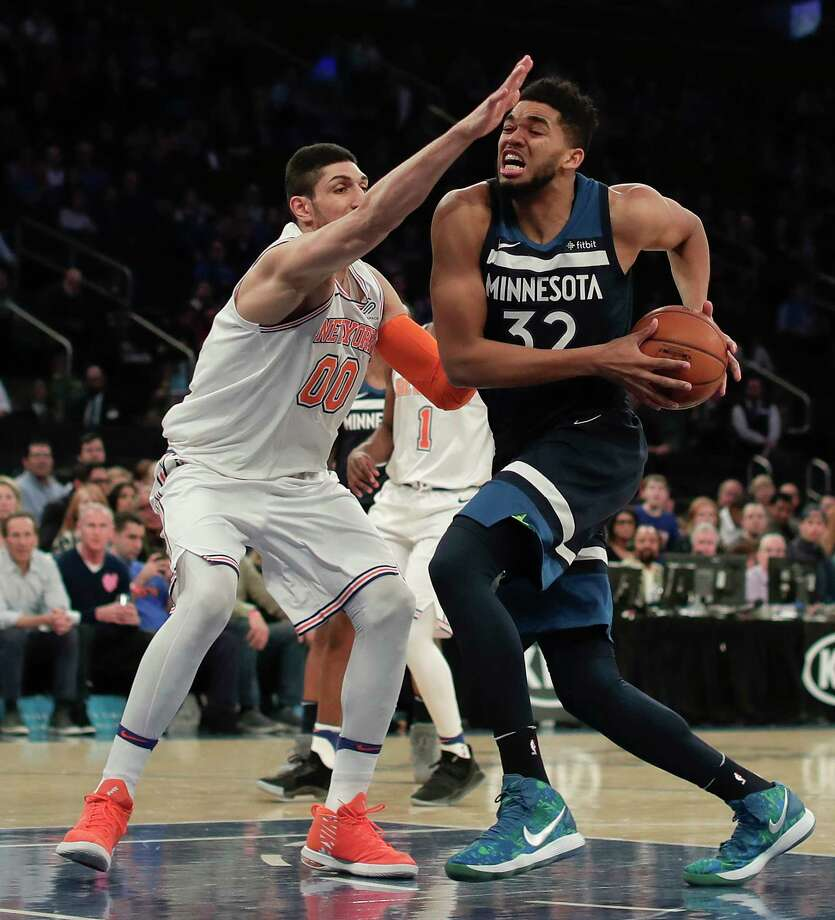 Minnesota Timberwolves center Karl-Anthony Towns (32) drives against New York Knicks center Enes Kanter (00) during the first quarter of an NBA basketball game, Friday, March 23, 2018, in New York. (AP Photo/Julie Jacobson) Photo: Julie Jacobson / Copyright 2018 The Associated Press. All rights reserved.