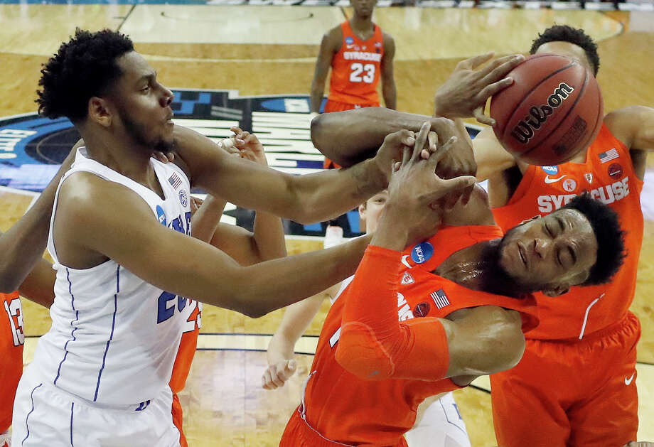 Syracuse's Oshae Brissett, right, and Duke's Marques Bolden reach for a rebound during the first half of a regional semifinal game in the NCAA men's college basketball tournament Friday, March 23, 2018, in Omaha, Neb. (AP Photo/Nati Harnik) Photo: Nati Harnik / Copyright 2018 The Associated Press. All rights reserved.