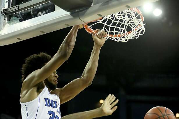 OMAHA, NE - MARCH 23:  Marvin Bagley III #35 of the Duke Blue Devils dunks the ball over Bourama Sidibe #35 of the Syracuse Orange during the second half in the 2018 NCAA Men's Basketball Tournament Midwest Regional at CenturyLink Center on March 23, 2018 in Omaha, Nebraska.  (Photo by Jamie Squire/Getty Images)