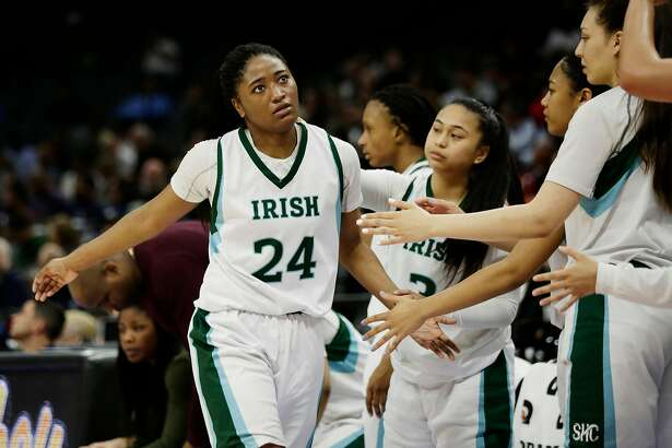 Sacred Heart Cathedral's Rainah Smith (24) fouls out against Serra-Gardena in the fourth quarter during the Division I girls 2018 CIF Basketball State Championships at Golden 1 Center on Friday, March 23, 2018, in Sacramento, Calif.