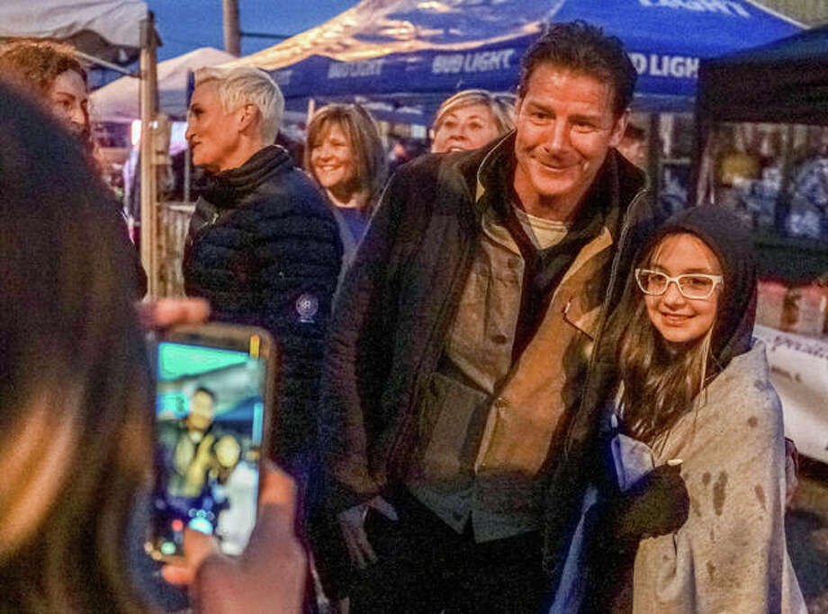 Small Business Revolution co-host Ty Pennington stops to take a photo with a young fan while his counterpart Amanda Brinking, left background, converses with an attendee of Friday night's announcement event. Photo: Nathan Woodside | For The Telegraph