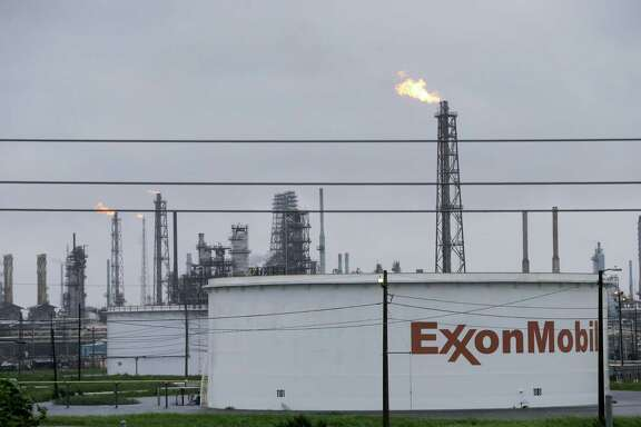 An ExxonMobil refining complex in Baytown. The company says it favors addressing climate change, but gives its money mostly to the opposition.