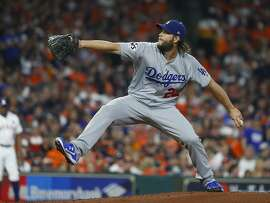Los Angeles Dodgers starting pitcher Clayton Kershaw (22) pitches during the first inning of Game 5 of the World Series at Minute Maid Park on Sunday, Oct. 29, 2017, in Houston. ( Karen Warren  / Houston Chronicle )