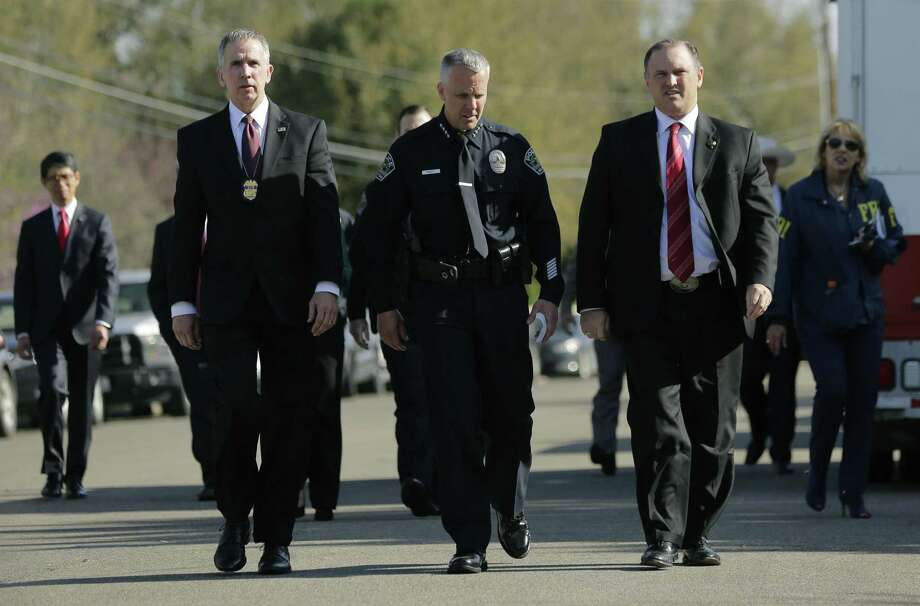 Bureau of Alcohol, Tobacco, Firearms and Explosives Special Agent in Charge Fred Milanowski, front left, Interim Austin police chief Brian Manley, front center, and FBI Special Agent in Charge Christopher Combs, front right, arrive for a news conference near the site of Sunday's explosion, Monday, March 19, in Austin.  Photo: Eric Gay, STF / Associated Press / Copyright 2018 The Associated Press. All rights reserved.