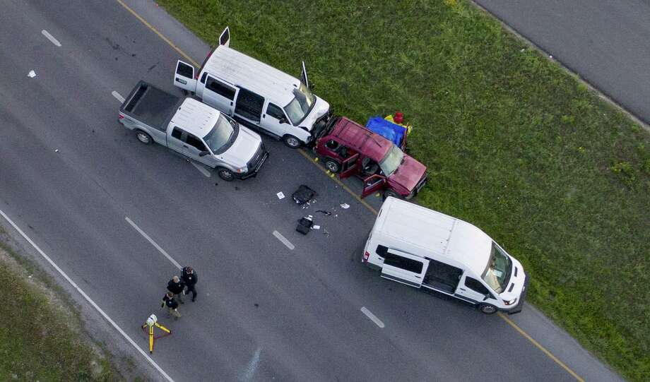 Officials investigate the scene where Mark Conditt himself up, off of Interstate 35 in Round Rock, Texas, Wednesday morning, March 21. Photo: JAY JANNER, PTR / NYT / AUSTIN AMERICAN-STATESMAN