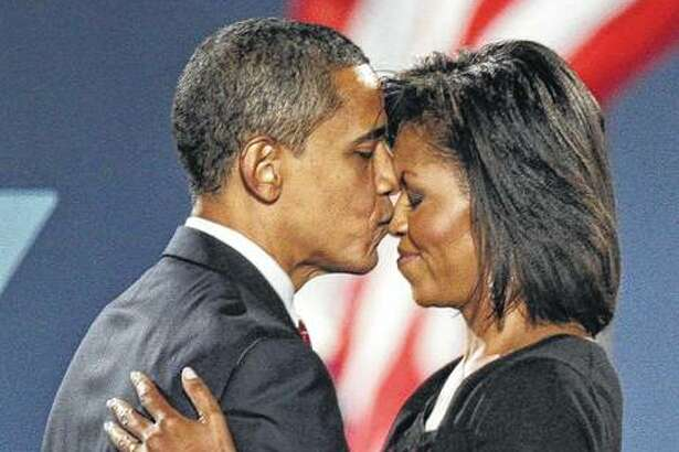 President-elect Barack Obama kisses his wife, Michelle, after his acceptance speech at his election night party at Grant Park in Chicago in 2008.