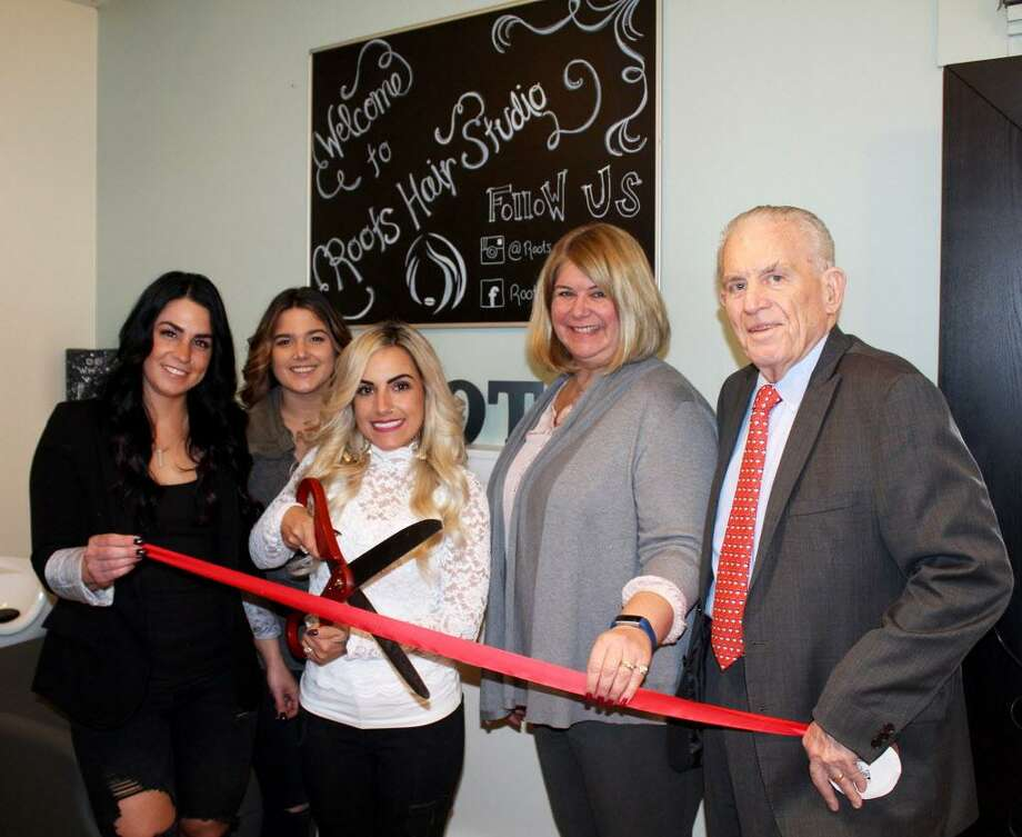 A grand opening was held for Roots Hair Studio at 1610 Saybrook Road, Haddam, March 12. From left are Hair Artists Jamie Jacobs and Melissa Gaerner, Owner Christina Bibisi, Haddam First Selectwoman Lizz Milardo and President of the Middlesex County Chamber of Commerce Larry McHugh. Photo: Contributed Photo