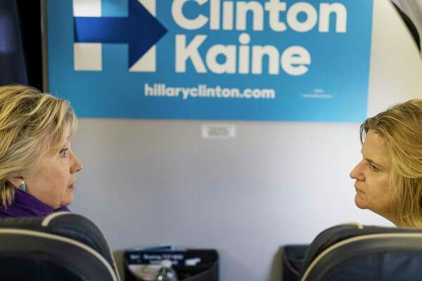 Hillary Clinton speaks to her communications director Jennifer Palmieri aboard the campaign plane in Philadelphia on Nov. 6, 2016.