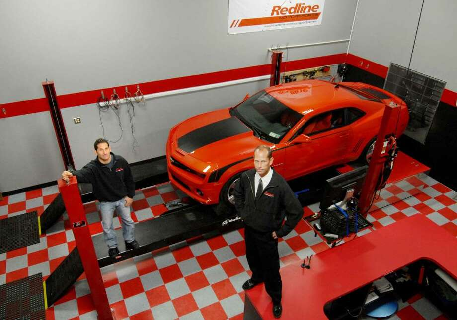 Howard Tanner, left, and Dan Coulton of  Redline Motorsports with a 2010 Camero in Rotterdam. (Michael P. Farrell / Times Union) Photo: MICHAEL P. FARRELL / 00006038A