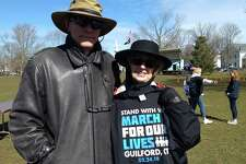 New Haven couple Mike Gill and Joanne Paone-Gill were among hundreds who arrived early at the Guilford Green to stand up for gun control.