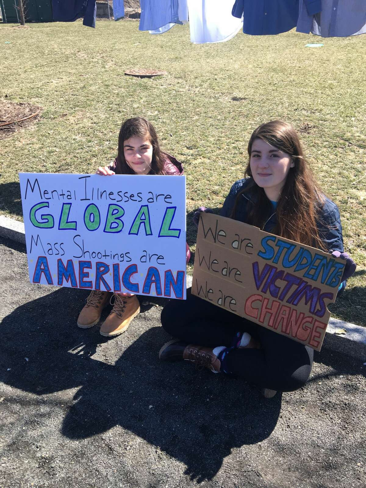 Rebecca Keyes (left) and Hannah Keyes (right), students at Norwalk High School, at the March for Our Lives in Stamford, Conn. on March 24, 2018.