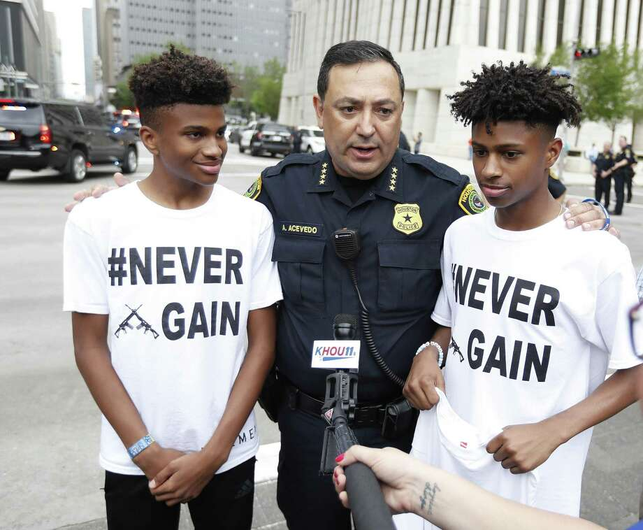 Houston Police Chief Art Acevedo talks with Harrison Maxwell, 15, and his brother, Maxwell, 13, during the March for Our Lives protest and march starting at Tranquility Park, Saturday, March 24, 2018, in Houston. After the recent mass shooting at Stoneman Douglas, students of the school have organized a nationwide protest including Houston, TX to plea for a strengthening of gun laws.  ( Karen Warren / Houston Chronicle ) Photo: Karen Warren, Staff / Houston Chronicle / © 2018 Houston Chronicle