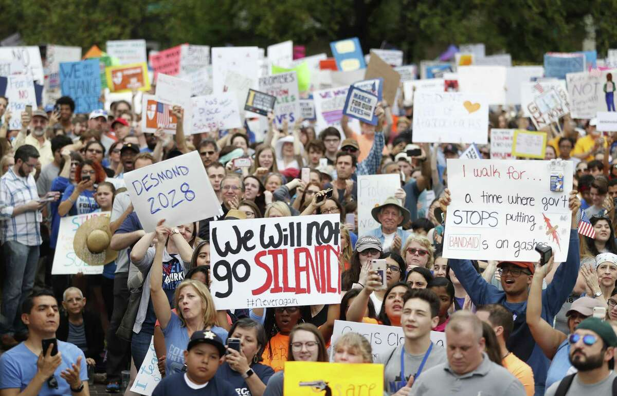 Protesters raise their signs as Mayor Sylvester Turner spoke to the crowd during the March for Our Lives protest and march starting at Tranquility Park, Saturday, March 24, 2018, in Houston. After the recent mass shooting at Stoneman Douglas, students of the school have organized a nationwide protest including Houston, TX to plea for a strengthening of gun laws. ( Karen Warren / Houston Chronicle )