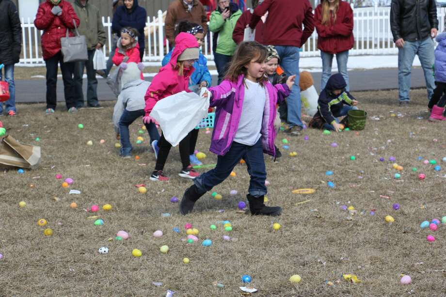 The hunt to find the most Easter eggs was in full effect Saturday afternoon at the Bad Axe Free Methodist Church. Dozens and dozens of children gathered outside and scoop up several eggs with tasty treats inside. Photo: Bradley Massman/Huron Daily Tribune