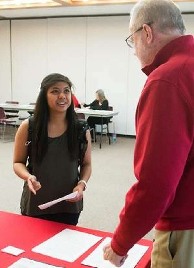 SIUE alumnus and prospective graduate student Jantzen Rosales visits with Mike Costigan, PhD, accounting professor emeritus, during the 2017 Graduate Admissions Open House. Photo: For The Telegraph