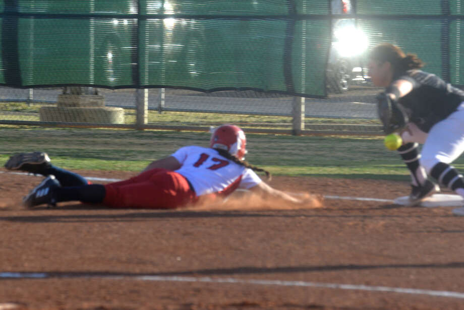 Plainview's Makayla Vasquez, 17, dives back to first base ahead of a throw from the Randall catcher during a District 3-5A game at Lady Bulldog Park Friday night. Photo: Skip Leon/Plainview Herald