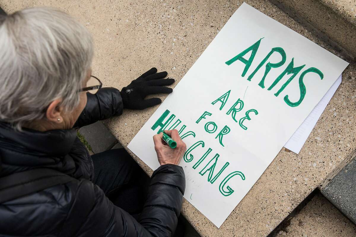 Elizabeth of Albany works on her sign before the start of the March For Our Lives rally held in support of gun control and youth activism Saturday, March 24, 2018 at Frank Ogawa Plaza in Oakland, Calif.