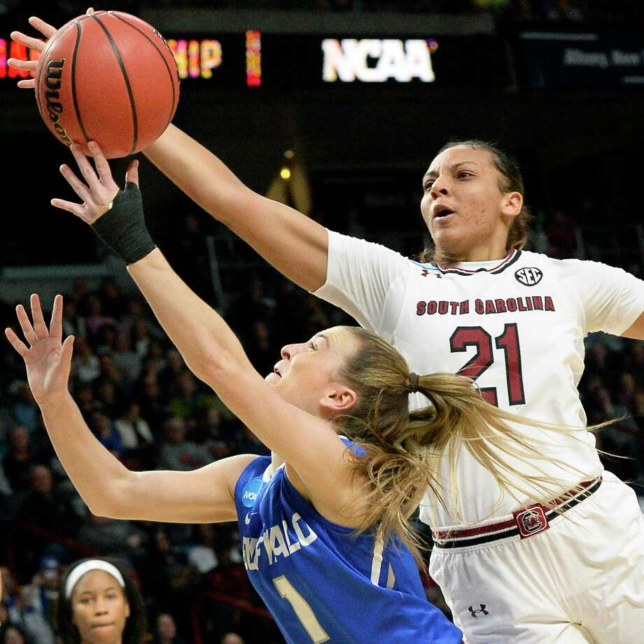South Carolina's #21 Mikiah Herbert Harrigan, right, and Buffalo's #1 Stephanie Reid battle under the basket during their NCAA Women's Basketball Tournament regional semifinal at the Times Union Center Saturday March 24, 2018 in Albany, NY.  (John Carl D'Annibale/Times Union) Photo: John Carl D'Annibale, Albany Times Union / 20043167A
