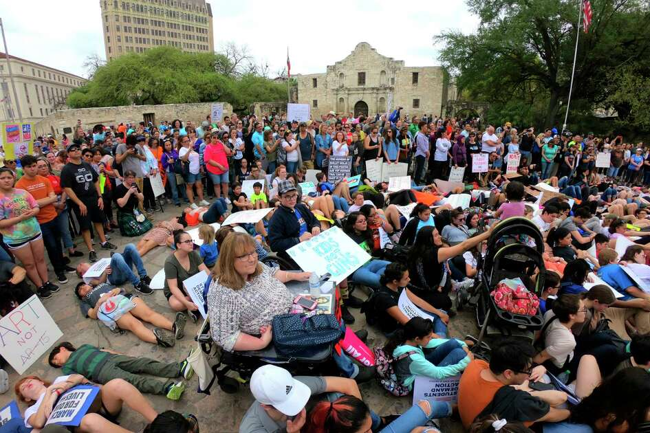Students lay and sit in front of the Alamo in remembrance of students killed in school shootings during the March for Our Lives San Antonio on Saturday, March 24, 2018. The event coincided with marches across America, inspired by the school shootings at Stoneman Douglas High School in Parkland, Fla.