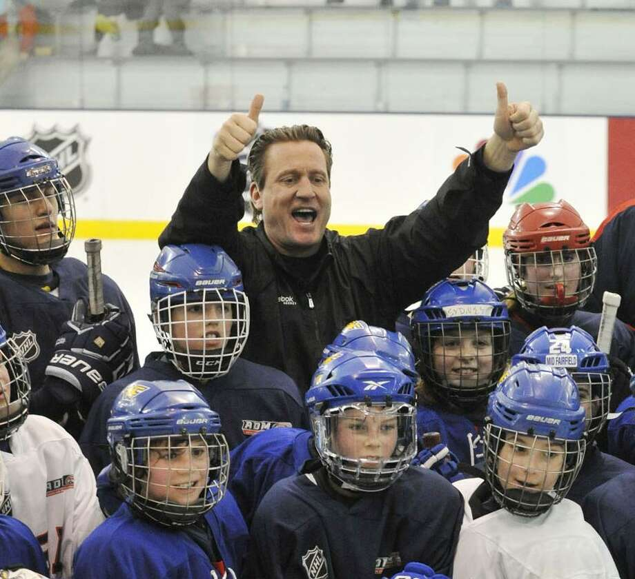 Jeremy Roenick, former NHL player and current NBC commentator, poses with kids at the end of Hockey Day in America at Chelsea Piers in Stamford, Conn., on Sunday, March 2, 2014. Photo: Jason Rearick / Jason Rearick / Stamford Advocate